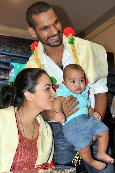 Shikhar Dhawan with his wife and daughter.