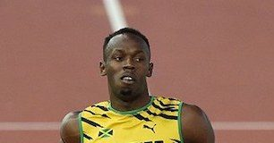 Usain Bolt during a relay race at Glasgow 2014 Commonwealth Games (featured image).