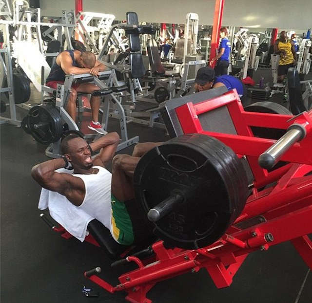"Usain Bolt working out his legs on ""Leg Press"" machine in the gym."