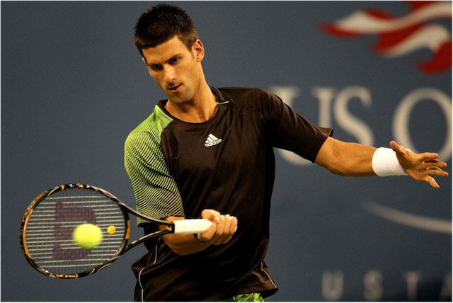 Novak Djokovic playing a shot during a match.