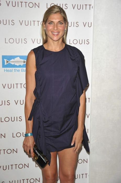 Gabrielle Reece wearing navy dress at Louis Vuitton store opening event at Santa Monica