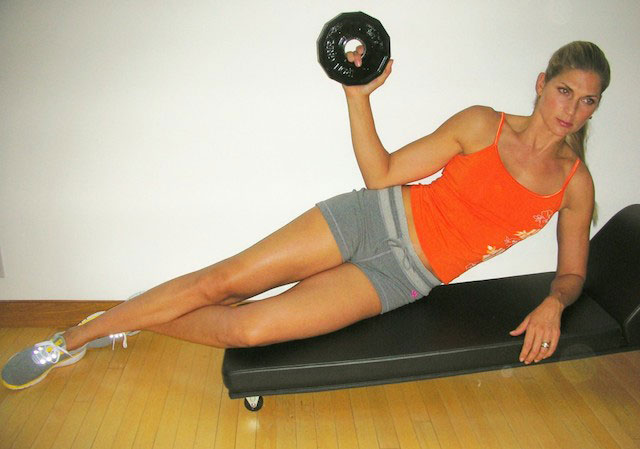Gabrielle Reece working out with weights