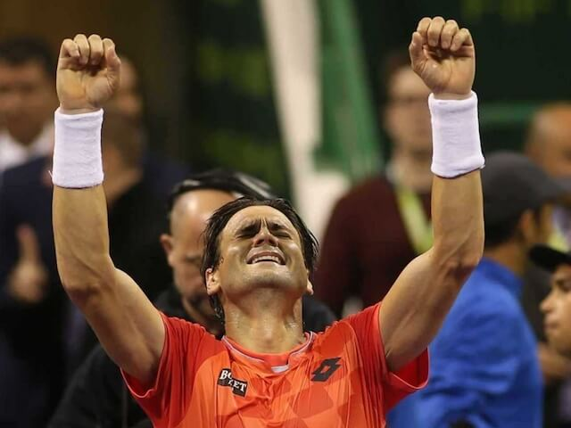 David Ferrer celebrating his tournament winning victory over Tomáš Berdych at Qatar ExxonMobil Open 2015