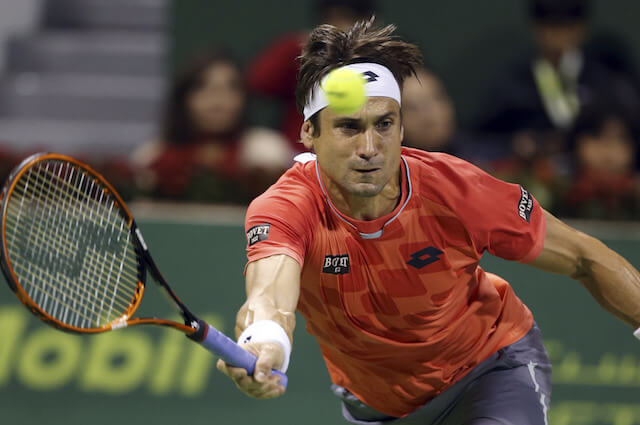 David Ferrer of Spain returns the ball against Tomas Berdych of Czech Republic during the final of the Qatar Open at the Khalifa tennis complex in Doha in 2015