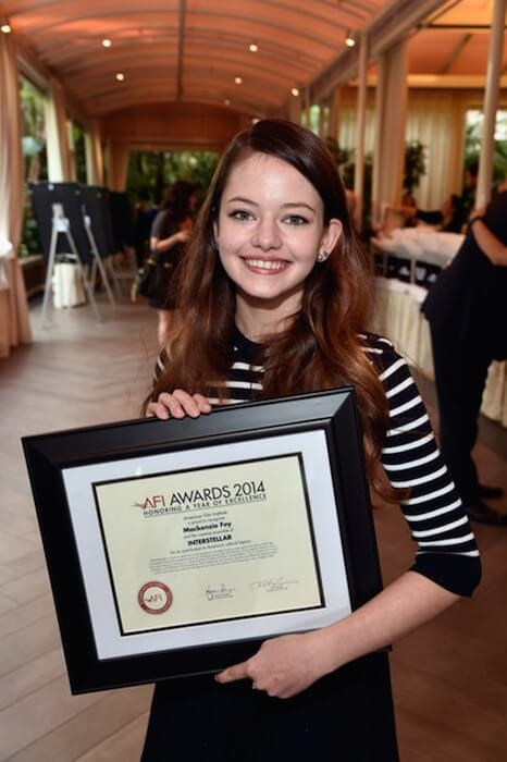 Mackenzie Foy shows her certificate received for 'Interstellar' at the 15th Annual AFI Awards in 2014