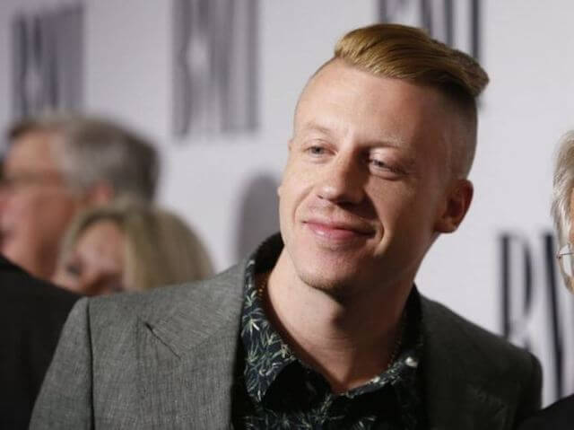 Macklemore poses at the 62nd Annual BMI Pop Awards in California