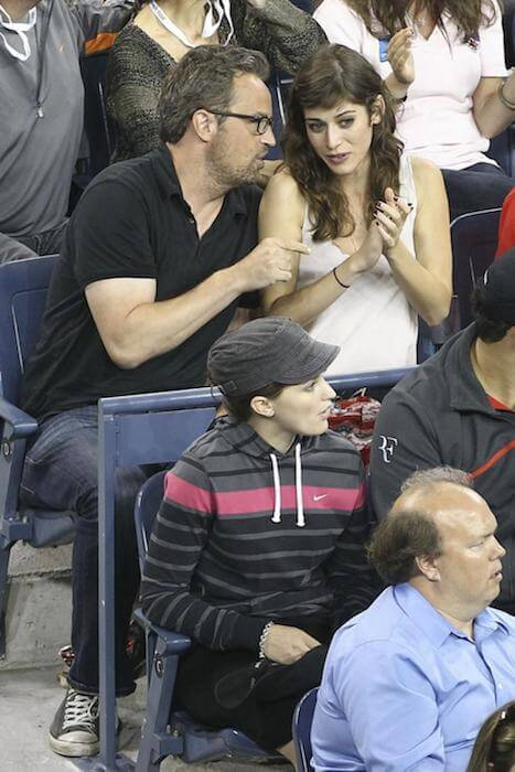 Matthew Perry and Lizzy Caplan watching tennis match - US Open 2011