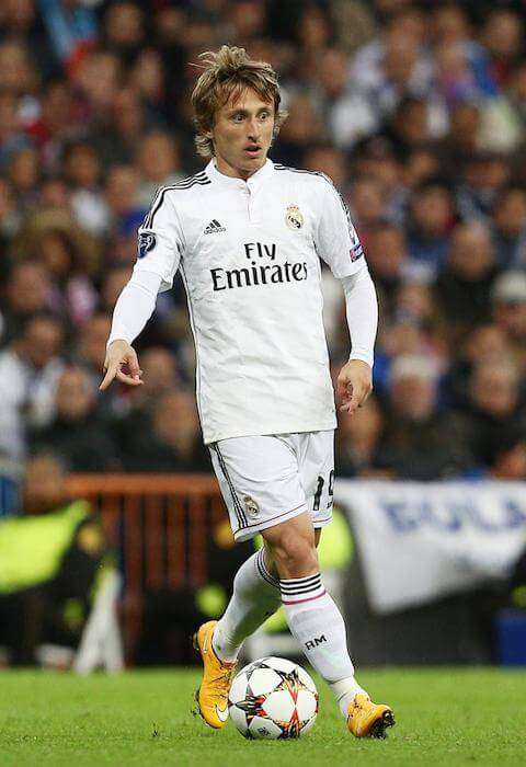 Real Madrid player, Luka Modric playing a shot