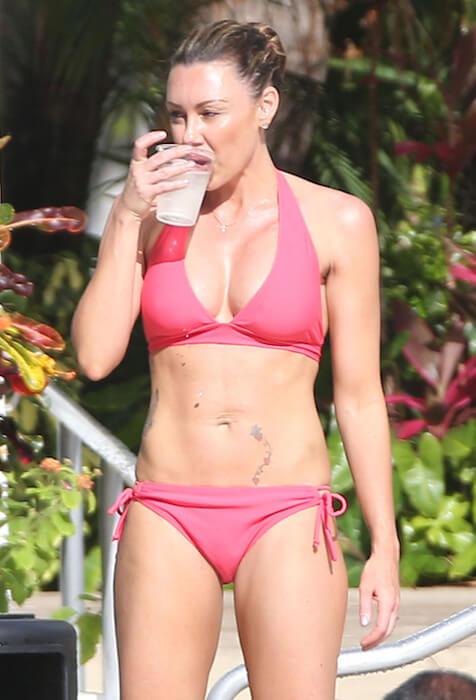 Michelle Heaton in bikini having her drink