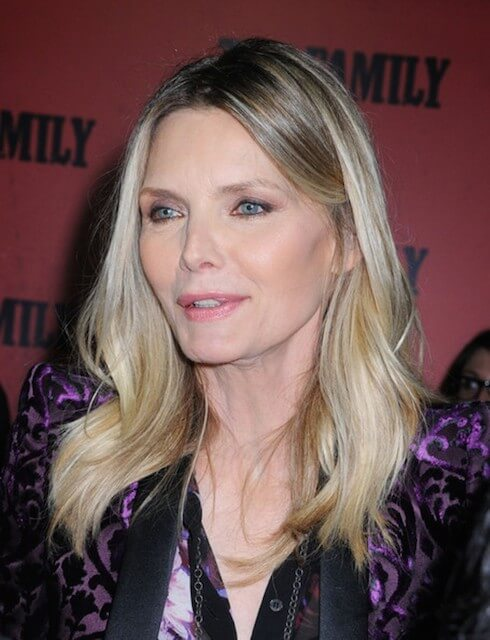Michelle pfeiffer arrives at the family premiere at the amc