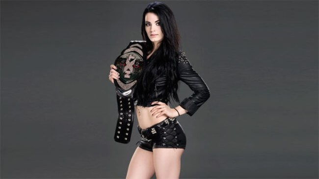 Paige with her NXT title during a photoshoot