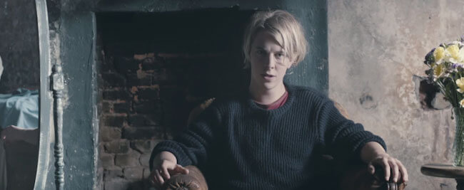 "Tom Odell in the music video of his song ""Another ..."
