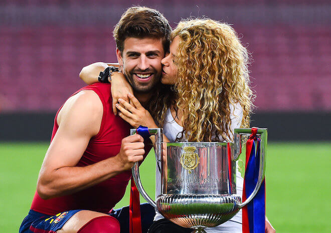 Gerard Pique of FC Barcelona and Shakira pose with the trophy after FC Barcelona won the Copa del Rey Final match against Athletic Club at Camp Nou