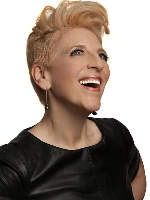 Lisa Lampanelli looking happy after surgery