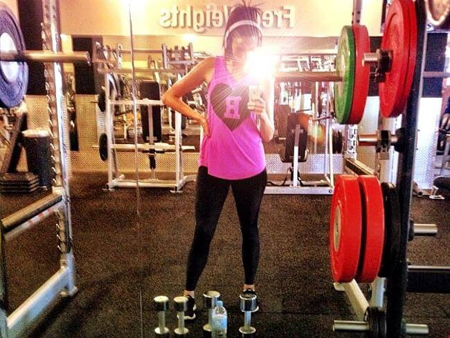 Ricki-Lee Coulter taking her own picture while in the gym
