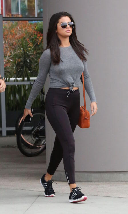 Selena Gomez in tights leaving a gym in West Hollywood in June 2015