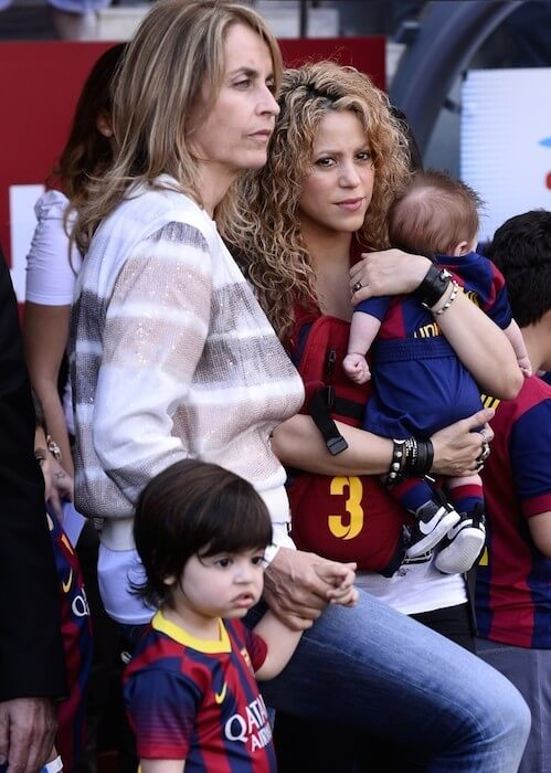 Shakira and her sons Milan (aged two) and-three-month old Sasha in their father's Barca uniform as the family cheered on the home team attending the soccer match of Pique