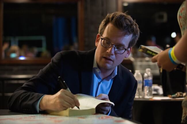 Writer John Green signing autographs for fans on his 'Get Lost Get Found' tour in Dallas, Texas in June 2015
