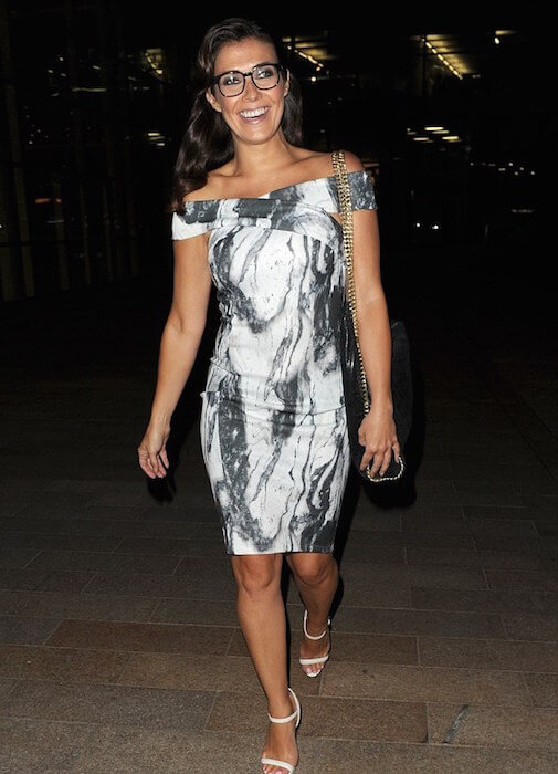 Kym Marsh in a marble print bodycon dress by Lavish Alice, making an exit from Media City, UK on 2nd July, 2015