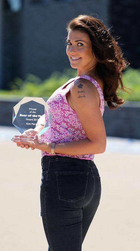 Kym Marsh with her 'Rear of the Year Winner 2015' trophy