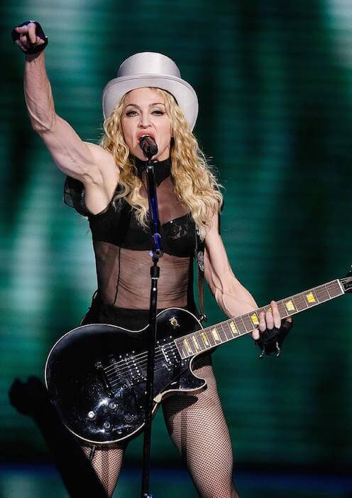 Pop star Madonna giving live performance.