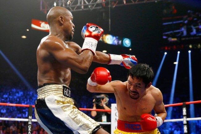 Manny Pacquiao throws his short right hook at Floyd Mayweather Jr. during their welterweight unification championship bout on May 2, 2015 at MGM Grand Garden Arena in Las Vegas, Nevada