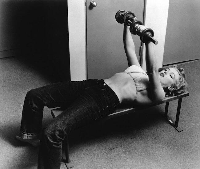 Marilyn Monroe doing dumbbell chest press