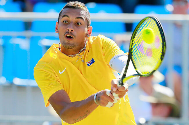Nick Kyrgios playing a shot against Aleksandr Nedovyesov at Davis Cup World Group quarterfinal on July 17, 2015 in Darwin, Australia