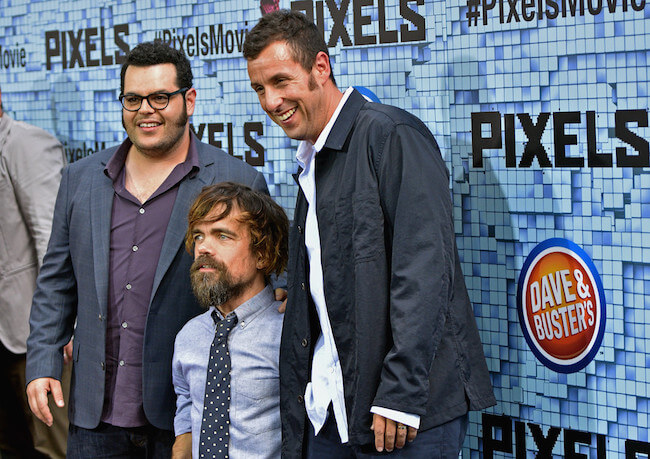 "Peter Dinklage with Josh Gad (Left) and Adam Sandler (Right) attend the ""Pixels"" New York Premiere at Regal E-Walk on July 18, 2015 in New York City"