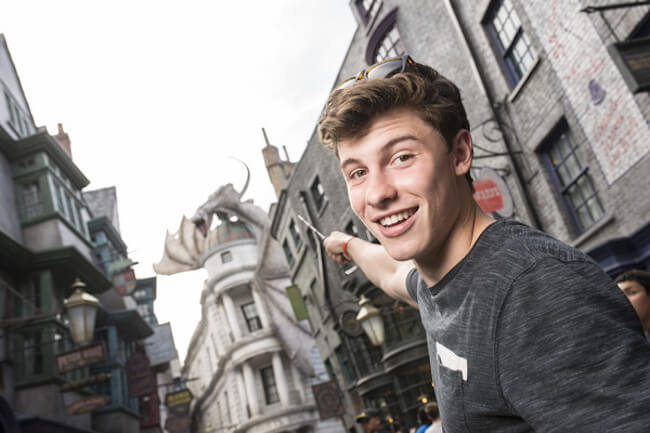 In this handout photo provided by Universal Orlando Resort, singer Shawn Mendes visits The Wizarding World of Harry Potter Diagon Alley at Universal Orlando on May 24, 2015 in Orlando, Florida. He explored Diagon Alley and even tried his hand at casting a spell or two