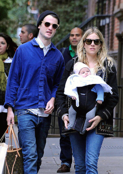 Sienna Miller and Tom Sturridge with daughter Marlowe during a walk in 2015