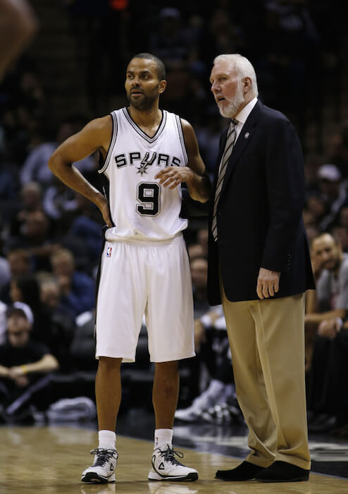 Tony Parker getting instructions from his coach Gregg Popovich during a game that San Antonio played against Atlanta Hawks on November 5, 2014