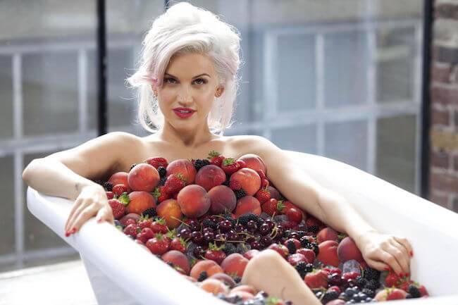 Ashley Roberts covered with fruits