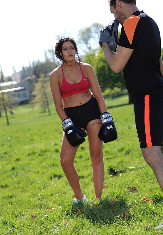 Chloe Etherington boxing with trainer