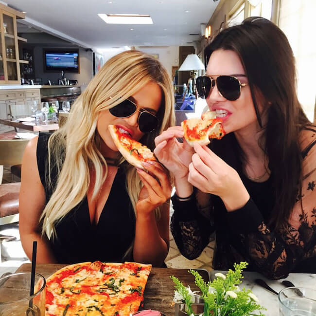 Kendall Jenner and Khloe Kardashian seen out in LA on June 23, 2015 eating pizza