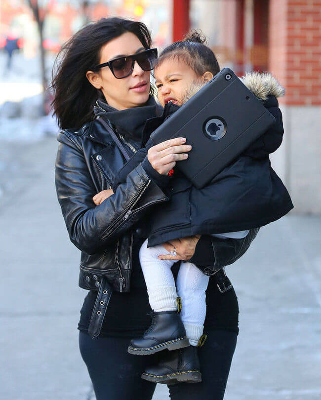 Kim Kardashian with North West: It seems that Kim finally caught her as she works out by chasing her these days and she is not too happy about it