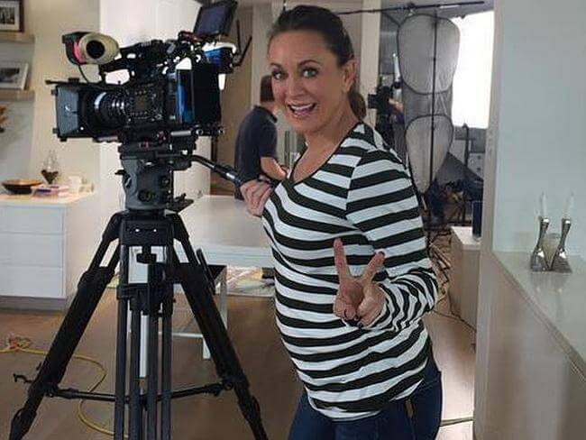 Michelle Bridges showing her baby bump