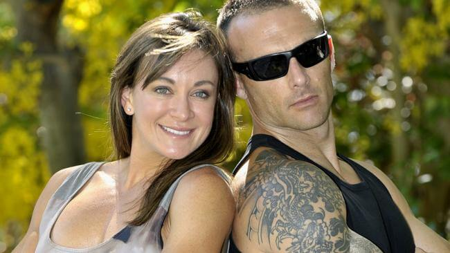 Michelle Bridges with her partner 'The Commando'