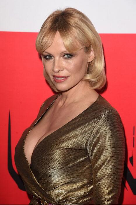 Pamela Anderson on the red carpet during the Gunman premiere in Los Angeles