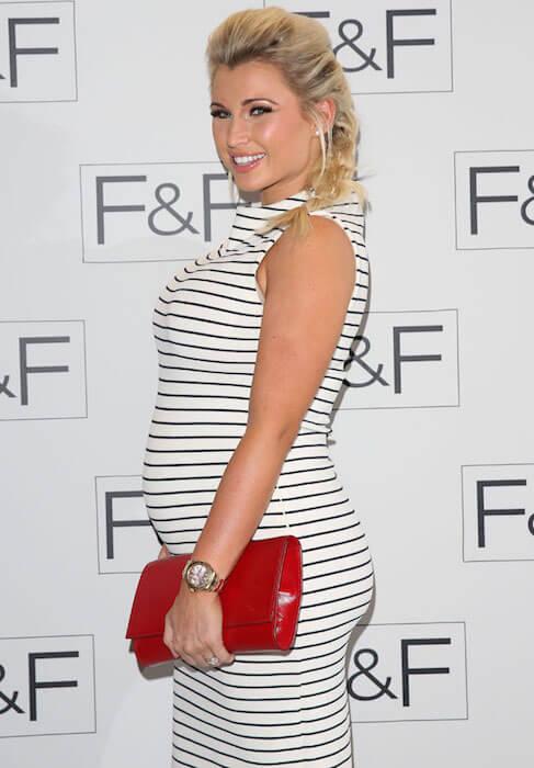 Pregnant Billie Faiers during Autumn / Winter 2014 fashion show