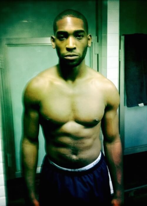 Tinie Tempah showing his buffed body