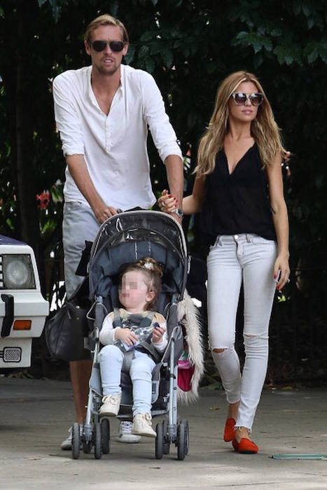 Abbey Clancy and Peter Crouch with their first daughter