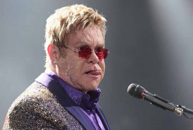 Elton John performing in a concert during his All the Hits Tour 2015