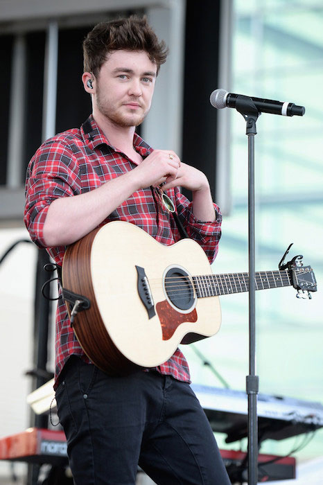 Jake Roche performing at Y100's Jingle Ball Village in December 2014