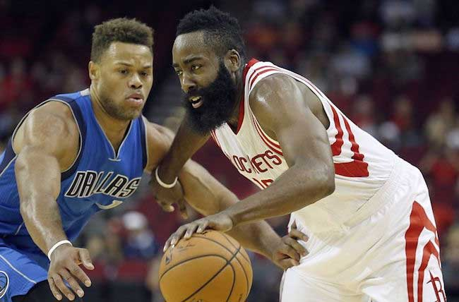 Justin Anderson of Dallas Mavericks (Left) defending James Harden of Houston Rockets (Right) during a NBA pre-season game
