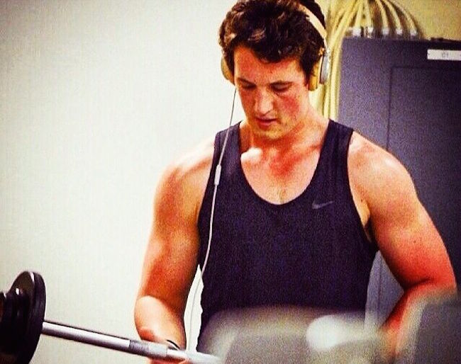Miles Teller working out in the gym