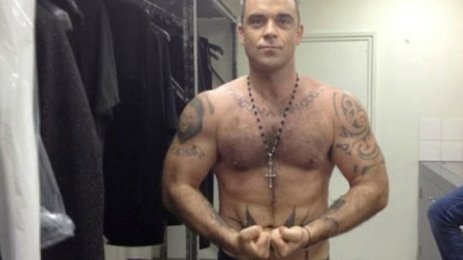 Robbie Williams showing his body