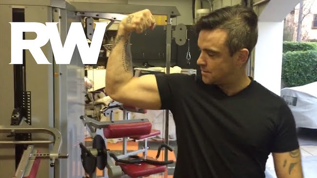 Robbie Williams showing his biceps