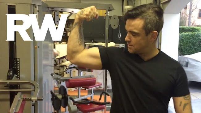 Robbie Williams showing his biceps
