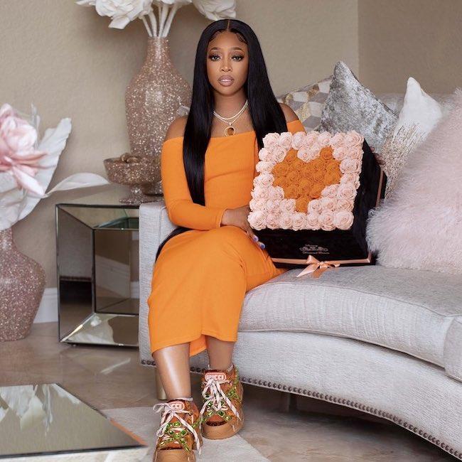 Trina wearing an orange dress in September 2020